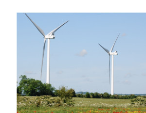 two wind turbines in field