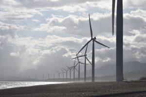 wind turbines on grey coast